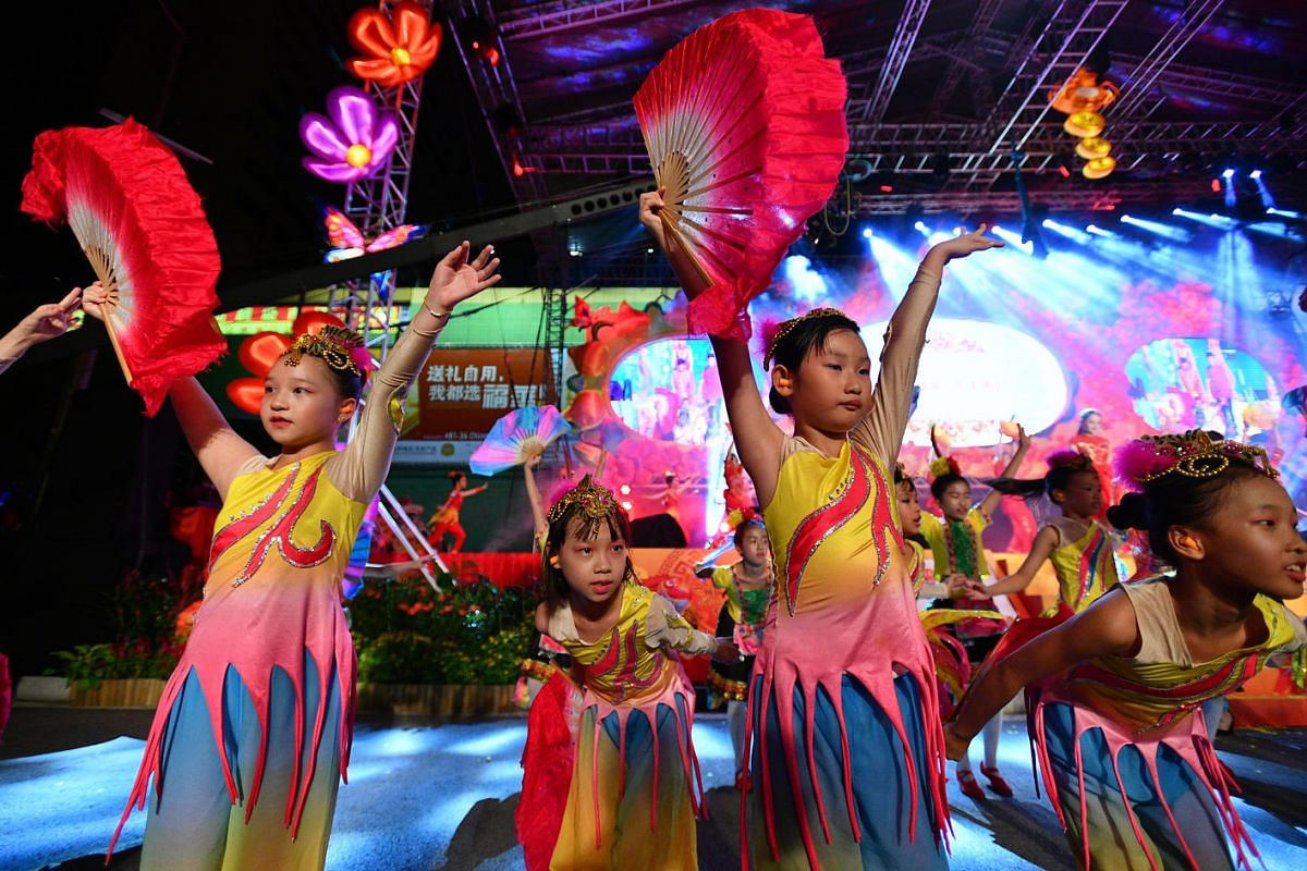 Students from Bukit View Primary School, Bukit Panjang Primary School, Woodgrove Primary School and Victoria Dance School performing during the Chinatown Chinese New Year Celebrations.