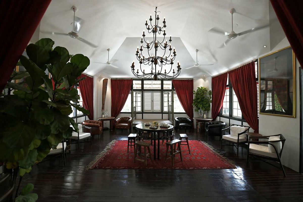 A lounge area of Villa Samadhi Singapore, which is located in a black-and-white, 20th-century military building.