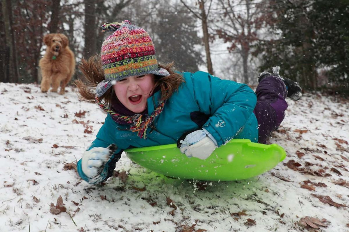 Ten-year-old Margaret Young sledding down a hill in Charlotte, North Carolina.