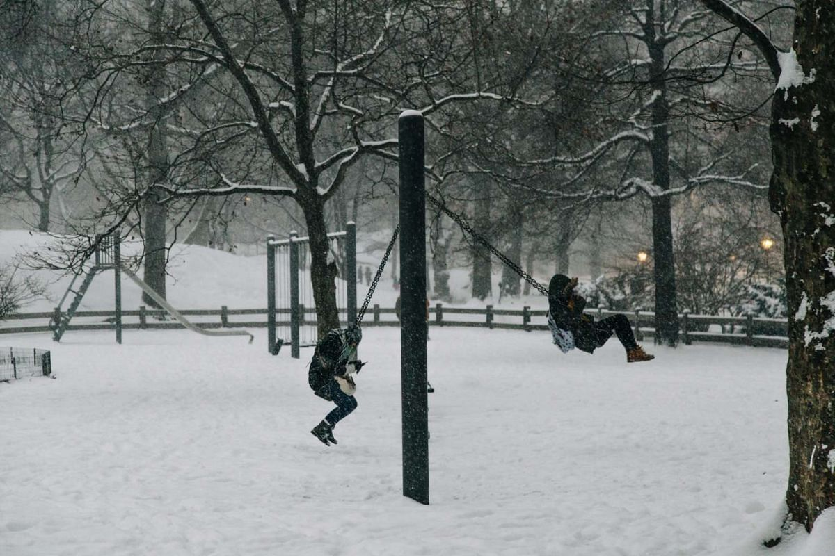 The thick blanket of snow did not stop parkgoers from playing on the swings in Central Park in New York.