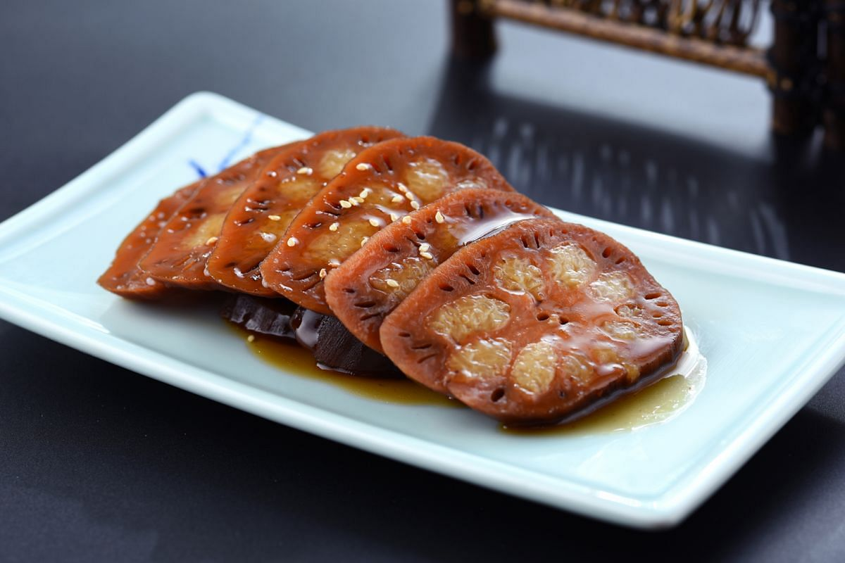 Go for the Honey Glazed Stuffed Lotus Root (above) and Sesame-scented Beancurd Julienne.