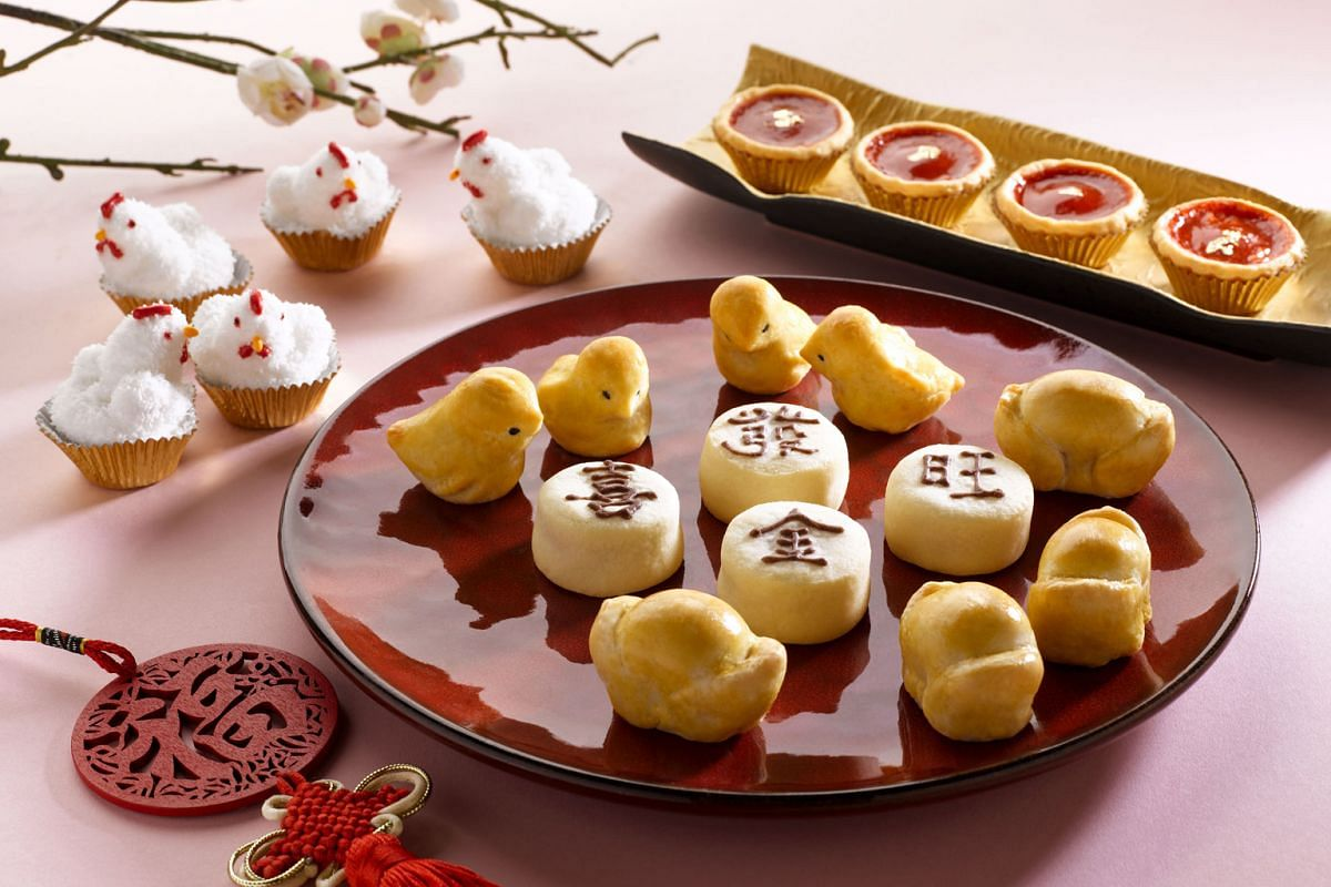 The Fullerton Hotel's rooster-inspired cookies, baked banana gold ingot cookies and Prosperity pineapple tarts.
