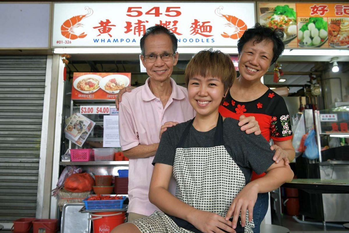 Hawker Li Rui Fang with her mother Goh Kwee Lee and father Lee Wong Leong, who help run the prawn noodle stall