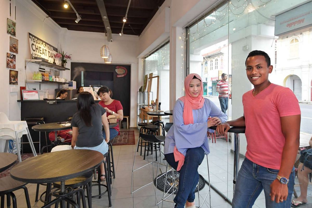 Cafe co-owner Nur Sherillin Mohamed Jabbar who, with co-owner husband Zulfadli Zainal Abidin, have made friends with many foreign workers living nearby