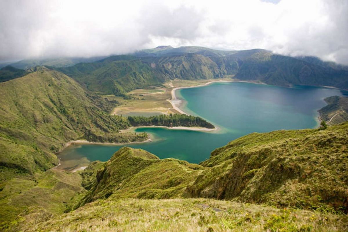 The Azores boasts a landscape of volcanoes, hot springs, towering cliffs and rugged craters.
