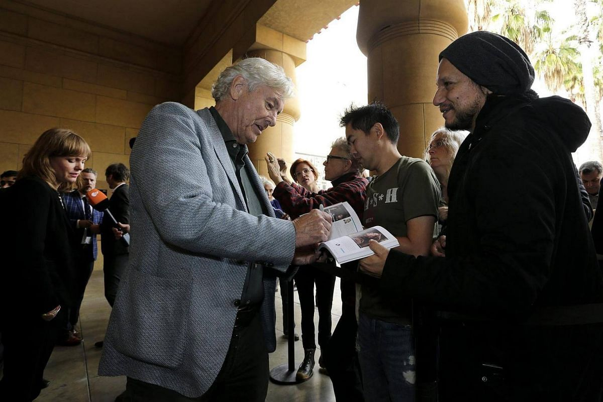 Dutch director Paul Verhoeven (left) signs an autograph at the Golden Globes Foreign Language Nominees Symposium in the forecourt of the Egyptian Theatre in Hollywood, California, US, on Jan 7, 2017.