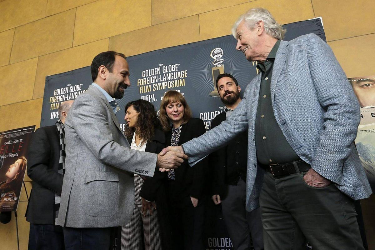 Dutch director Paul Verhoeven (right) shakes hands with Iranian director Asghar Farhadi (left) at the Golden Globes Foreign Language Nominees Symposium in the forecourt of the Egyptian Theatre in Hollywood, California, US, on Jan 7, 2017.