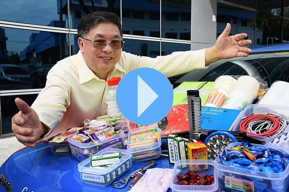 Taxi driver Ong Swee Ker supplies his passengers with biscuits, lozenges, bottled water, medicated oil and umbrellas, among other things.