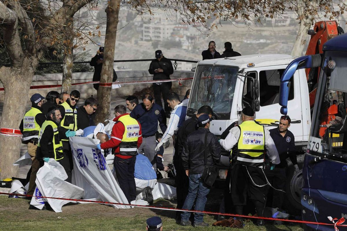"""A truck plowed into a group of soldiers in Jerusalem in what police said was a """"possible terrorist attack"""" in which at least four were killed and a number of people injured, January 8, 2017.  PHOTO: AFP"""