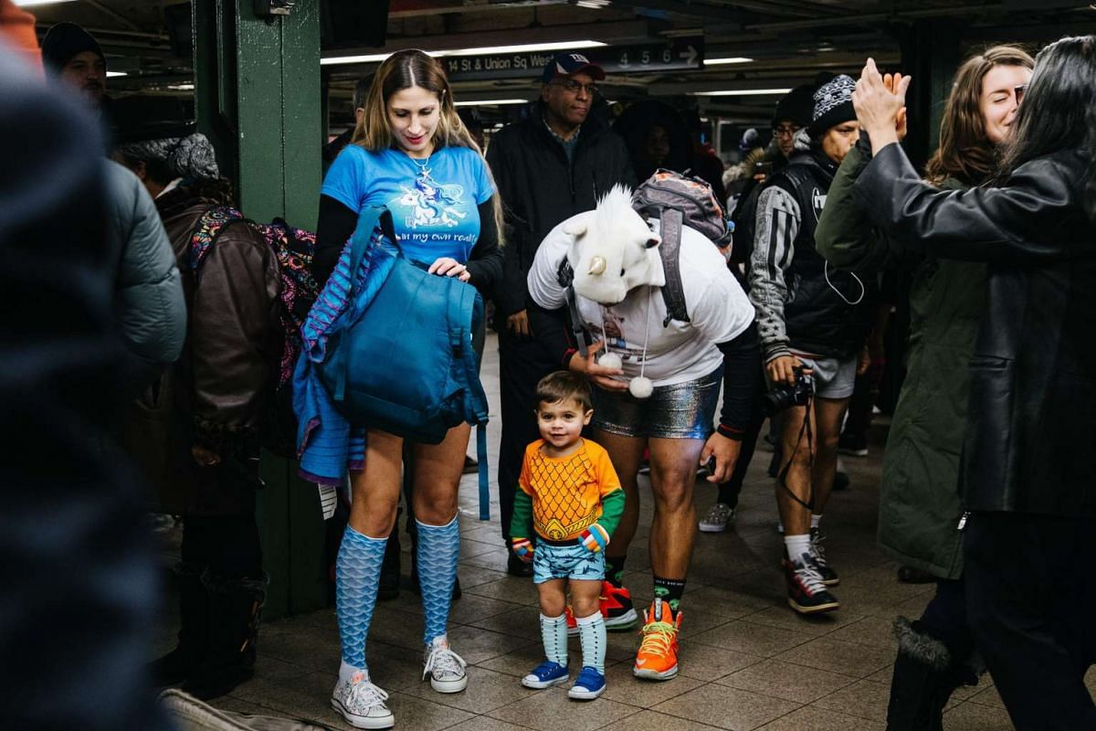 A child joins young people wearing no pants to participate in the 'No Pants Subway Ride' in New York, USA, January 8, 2017. No Pants Subway Ride is an annual global event started in New York, USA in 2002. PHOTO: EPA