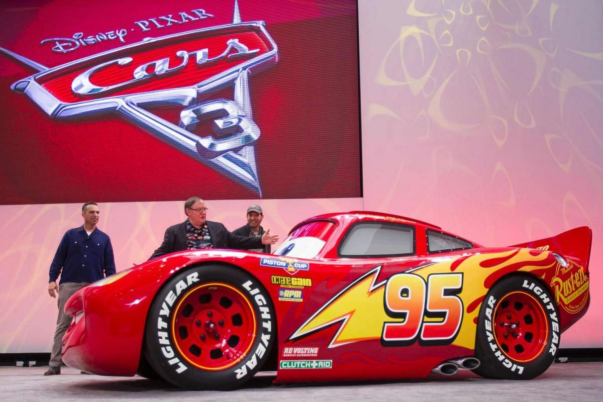 A lifesize version of Lightning McQueen drives onstage to unveil his new paint job for the upcoming movie Cars 3 during a press conference at the 2017 North American International Auto Show in Detroit, Michigan, January 8, 2017. PHOTO: AFP
