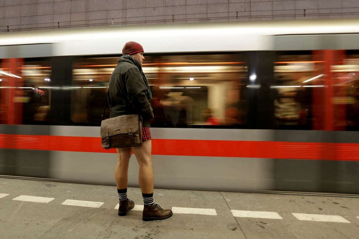 """A passenger not wearing pants waits for a subway train during the """"No Pants Subway Ride"""" in Prague, Czech Republic on Jan 8, 2017"""