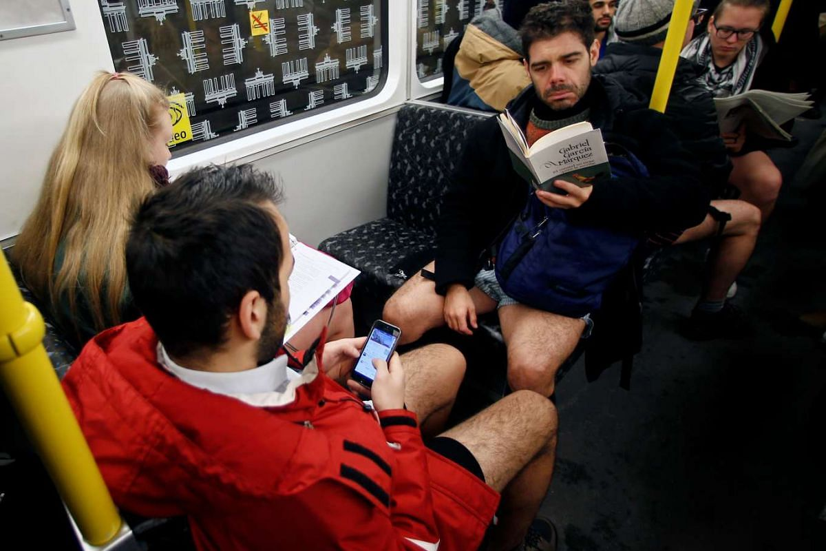 """People take part in the annual """"No Pants Subway Ride"""" in Berlin, Germany on Jan 8, 2017"""