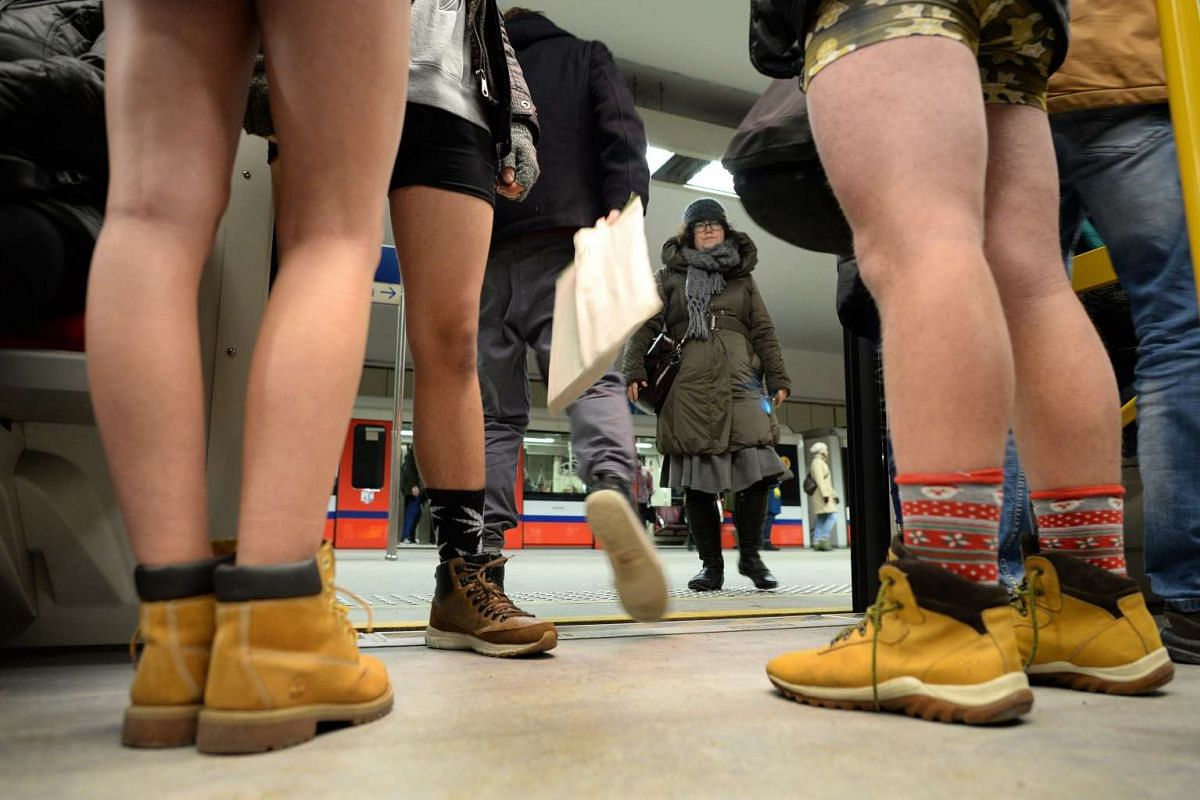 """Young people wearing no pants participate in the """"No Pants Subway Ride"""" in Warsaw, Poland on Jan 8, 2017"""