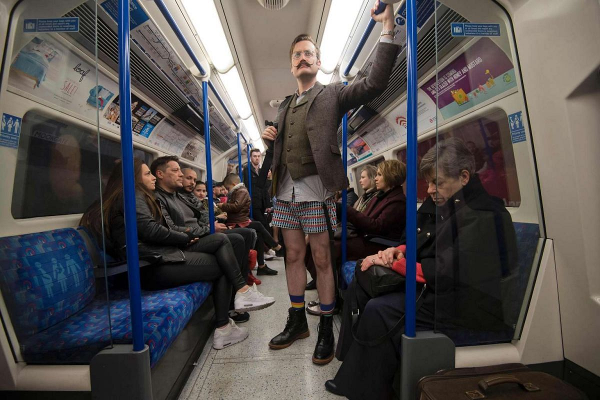 """People take part in the annual """"No Trousers On The Tube Day"""" (No Pants Subway Ride) on a London Underground tube train event in central London on Jan 8, 2017."""