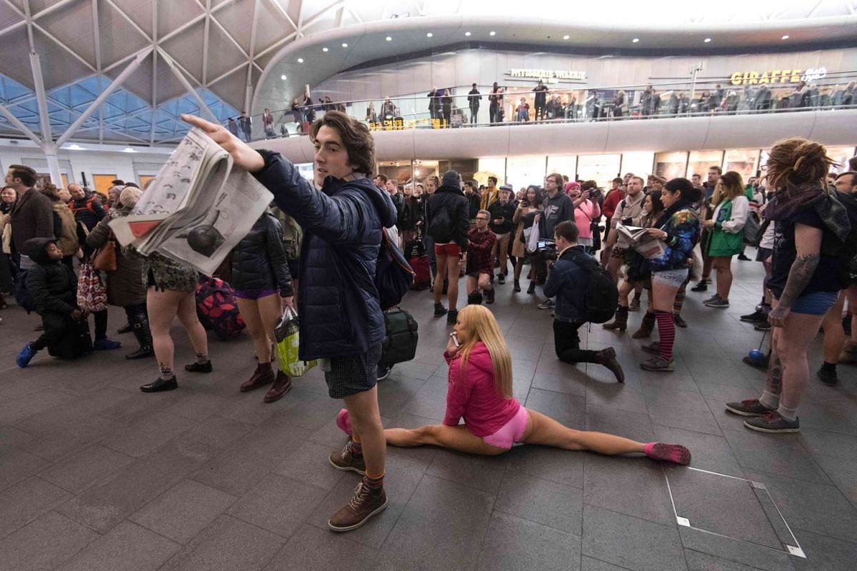 "People do the ""Mannequin Challenge"" as take part in the annual ""No Trousers On The Tube Day"" (No Pants Subway Ride) at King's Cross station in central London on Jan 8, 2017."