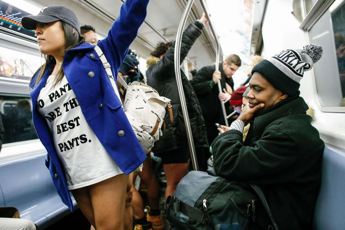 """A woman without pants travels in the subway during the """"No Pants Subway Ride"""" in New York on Jan 8, 2017."""
