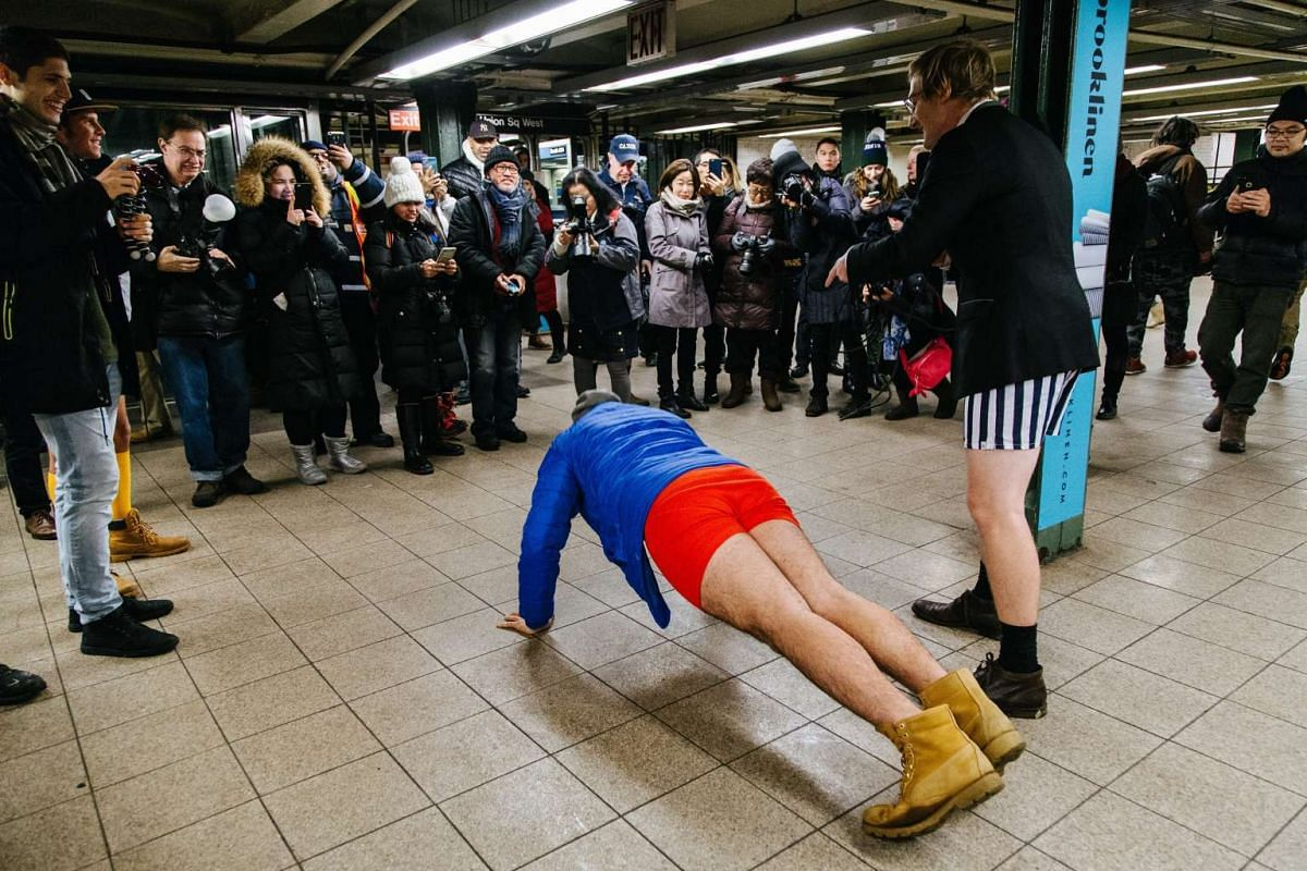 """A participant wearing no pants entertains the crowd during the """"No Pants Subway Ride"""" in New York on Jan 8, 2017"""