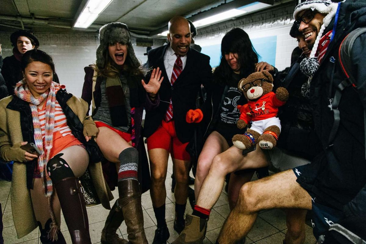 """Young people wearing no pants participate in the """"No Pants Subway Ride"""" in New York on Jan 8, 2017"""