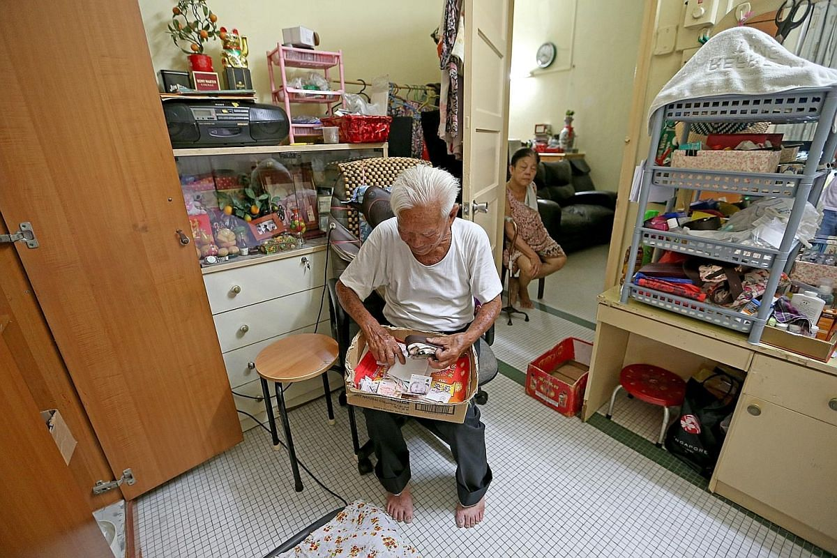 Mr Foo knows some of the domestic helpers who work in houses along his regular route so well that he lets them open the doors of his 17-year-old Toyota HiAce and collect the groceries they want themselves. Mr Foo takes a break at home after his morni