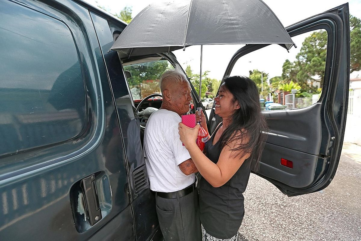 Ms Evelyn Queturas gives Mr Foo a tearful hug after she learns that the elderly man is giving up his 55-year-old business this week. The Filipino helper, who lives in Seletar Hills Estate, has been buying bread from him for 12 years.