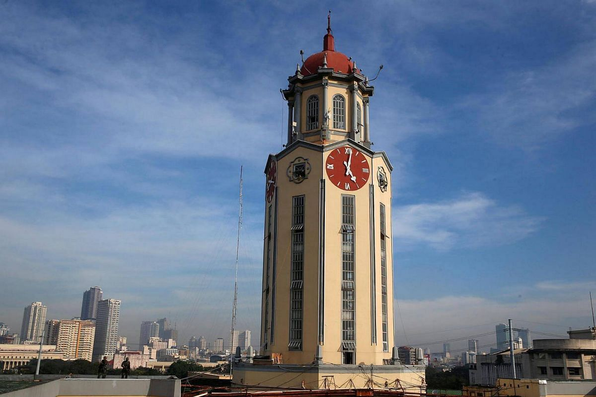Members of Special Action Force policemen standing guard beside a clock tower of the Manila City Hall where the Black Nazarene religious procession will pass on a road beside the city hall in Manila, Philippines, on Jan 9, 2017.