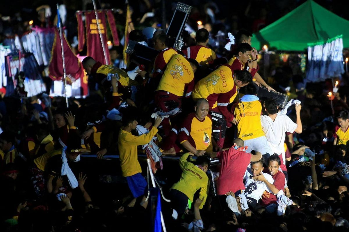 Devotees trying to hold the Black Nazarene during an annual procession in Rizal park, metro Manila, Philippines, on Jan 9, 2017.