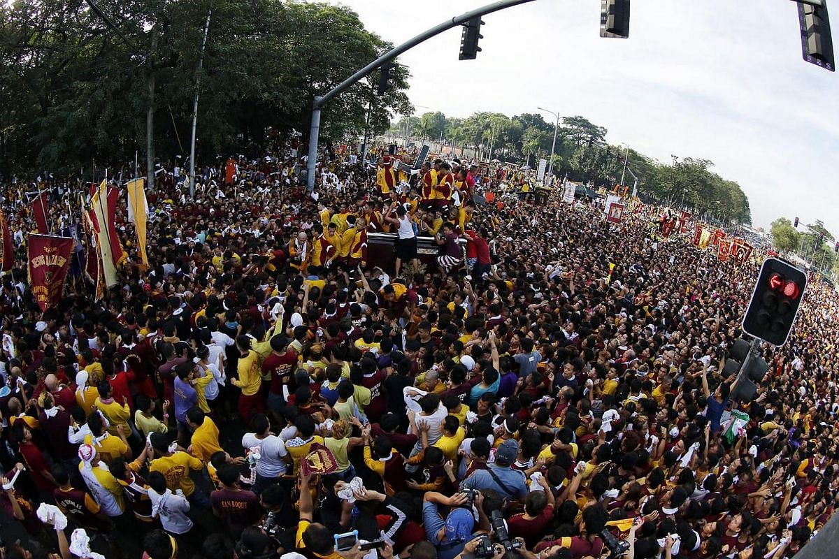 Filipino devotees jostling to reach the statue of the Black Nazarene during the procession in Manila, Philippines, on Jan 9, 2017.