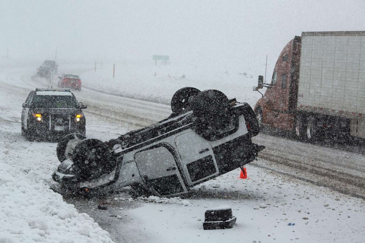 An overturned vehicle is seen on Highway 395 near Mammoth Lakes, California, January 9, 2017 as a series of strong storms moves through the western US state. PHOTO: AFP
