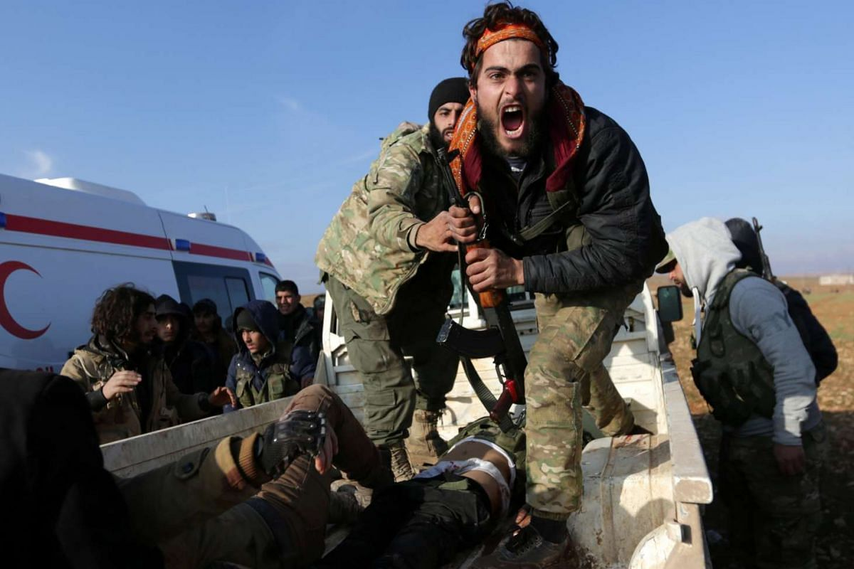 A Free Syrian Army (FSA) fighter reacts as he mourns near the body of his brother, who was an FSA fighter and died during an offensive against Islamic State fighters to take control of Qabasin town, on the outskirts of the northern Syrian town of al-
