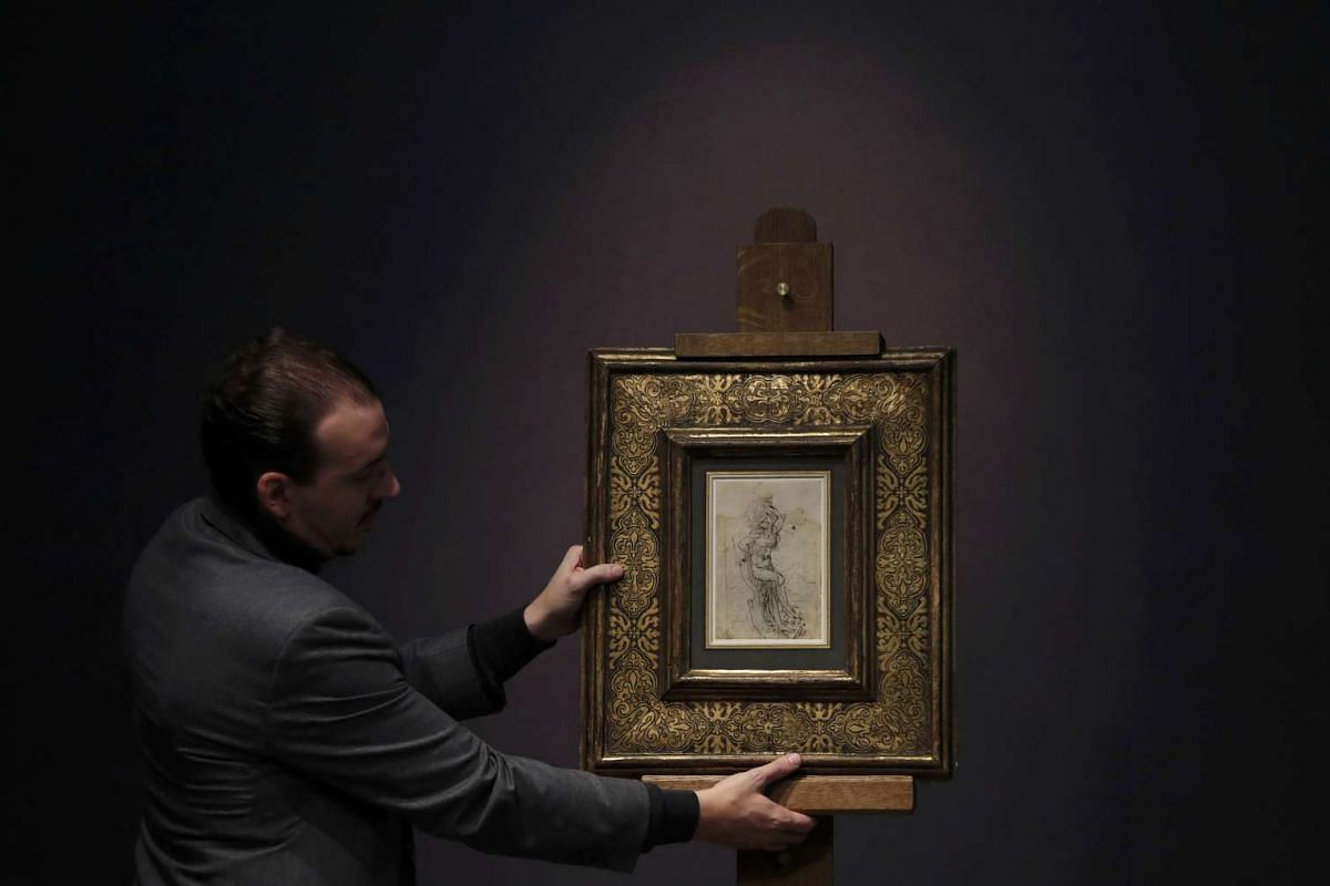 """French auction house Tajan employee displays a rare work representing """"The Martyred Saint Sebastian"""" identified as being drawn by Leonardo da Vinci and estimated for 15 million euros during a media presentation in Paris, France, January 10, 2017. PHO"""