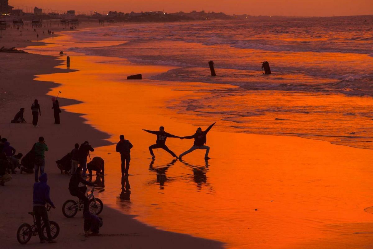 Palestinians show their skills on the beach during the sunset in Gaza City on January 10, 2017. PHOTO: AFP