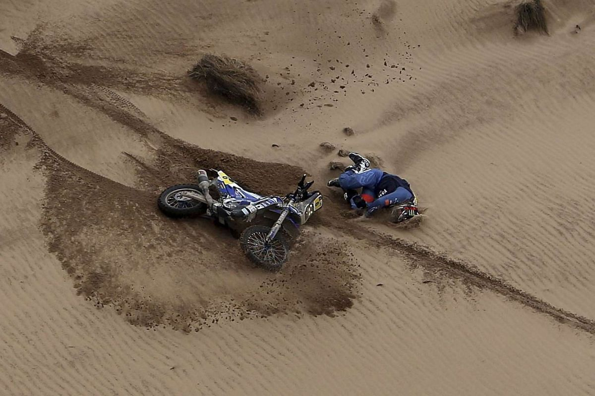 Adrien Van Beveren of France falling from his Yamaha motorbike during the Stage 7 of the Dakar Rally in Bolivia, on Jan 9, 2017.