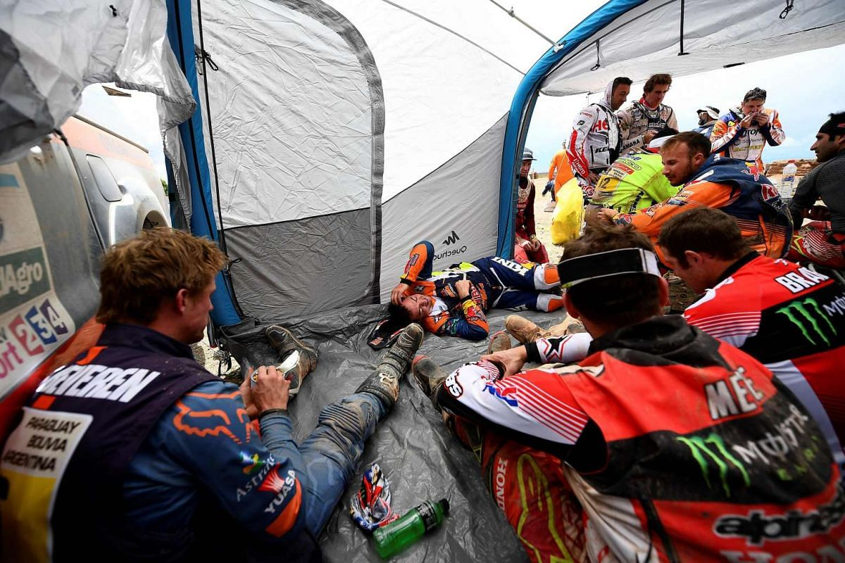Bikers resting during Stage 8 of the Dakar Rally between Uyuni in Bolivia and Salta in Argentina, on Jan 10, 2017.
