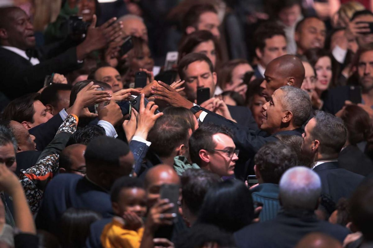 US President Barack Obama greets guests following his farewell speech to the nation in Chicago, Illinois on Jan 10, 2017.