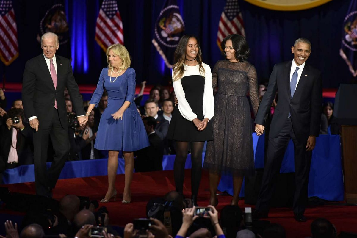 "US President Barack Obama (right) is joined on stage by US First Lady Michelle Obama, their daughter Malia Obama, Vice-President Joseph ""Joe"" Biden and his wife Jill Biden after his farewell address in Chicago, Illinois on Jan 10, 2017."