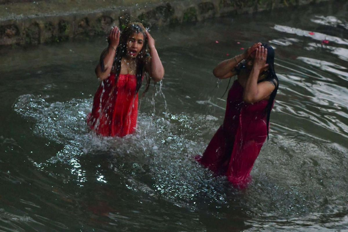 Nepalese Hindu devotees gather to bathe in the Shali River on the outskirts of  Kathmandu, Nepal on Jan 12, 2017. Hundreds of married and unmarried women in the Himalayan nation have started a month-long fast in the hope of a prosperous life and conj