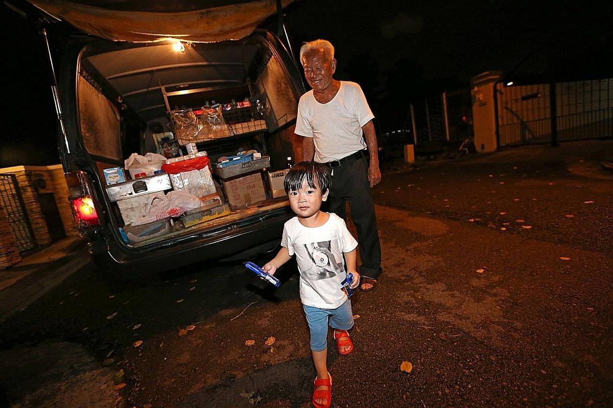 Mr Foo Kee See with two-year-old Ryder Koh during his final round selling provisions in Serangoon Gardens and Seletar Hills Estate on Jan 11, 2017.