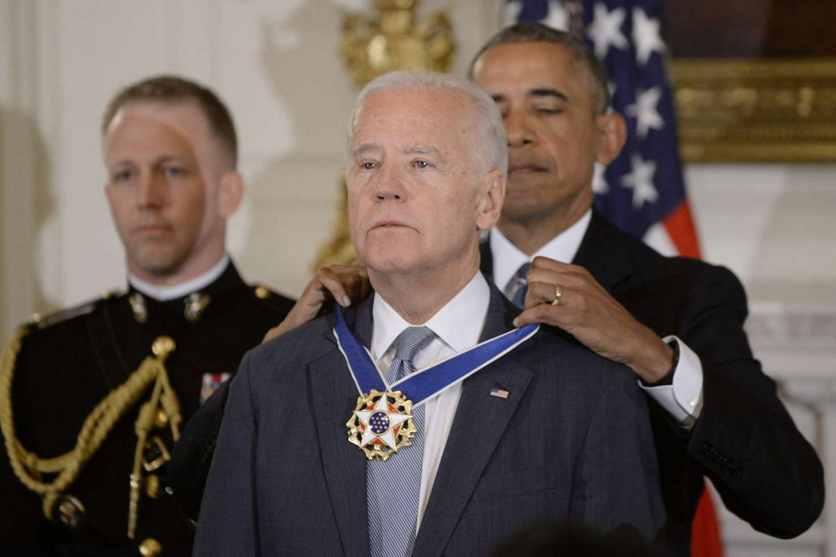 U.S. President Barack Obama presents the Medal of Freedom to U.S. Vice President Joe Biden during an event at the White House in Washington, D.C., U.S., on Thursday, January 12, 2017. PHOTO: BLOOMBERG/SIPA USA