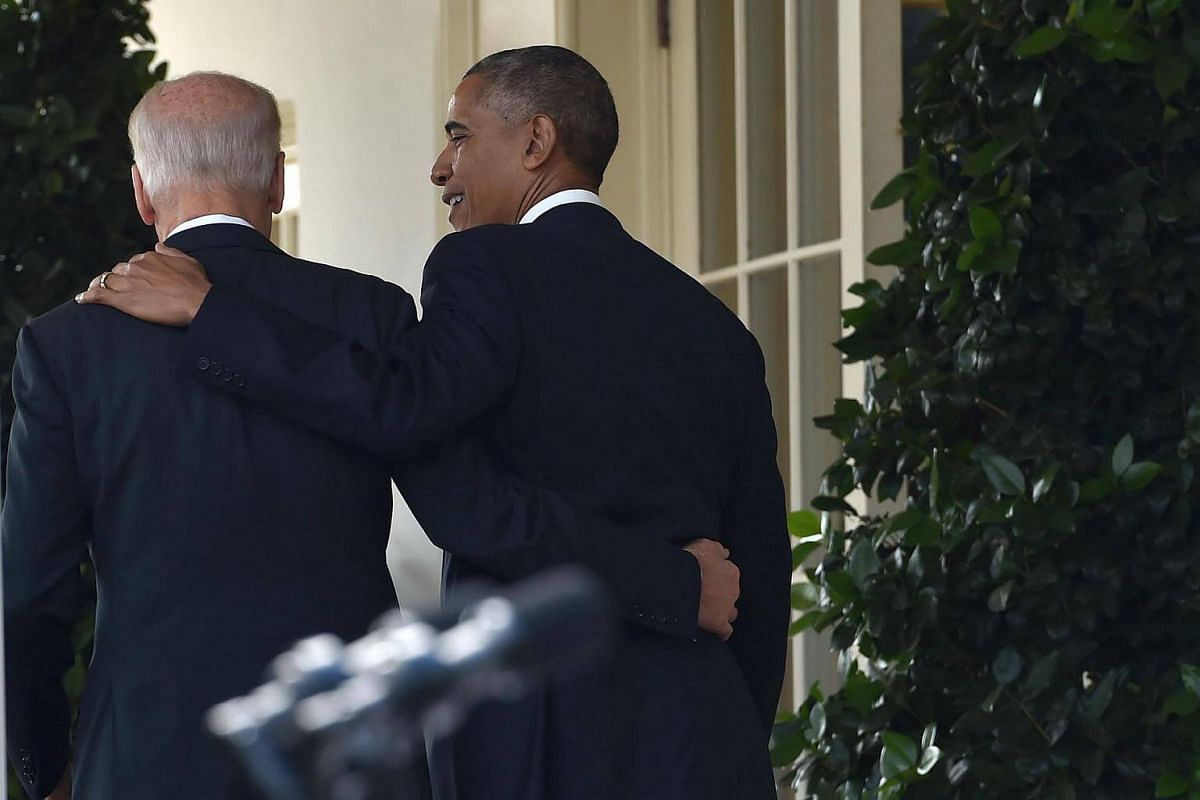 US President Barack Obama (right) leaving together with  Vice-President Joe Biden (left) after he addressed the nation publicly for the first time since the shock election of Donald Trump as his successor, on Nov 9, 2016, at the White House in Washin