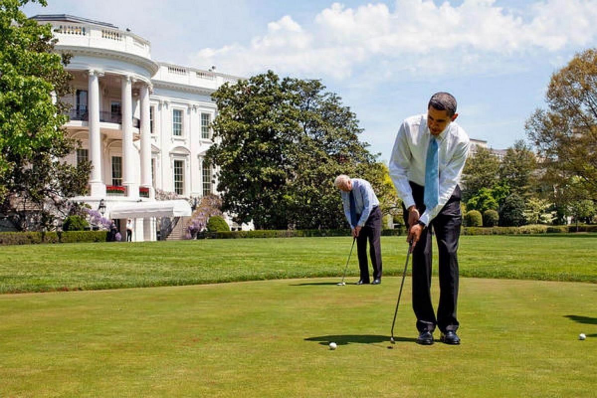 President Barack Obama and  Vice-President  Joe Biden practice putting on the White House putting green on April 24, 2009.