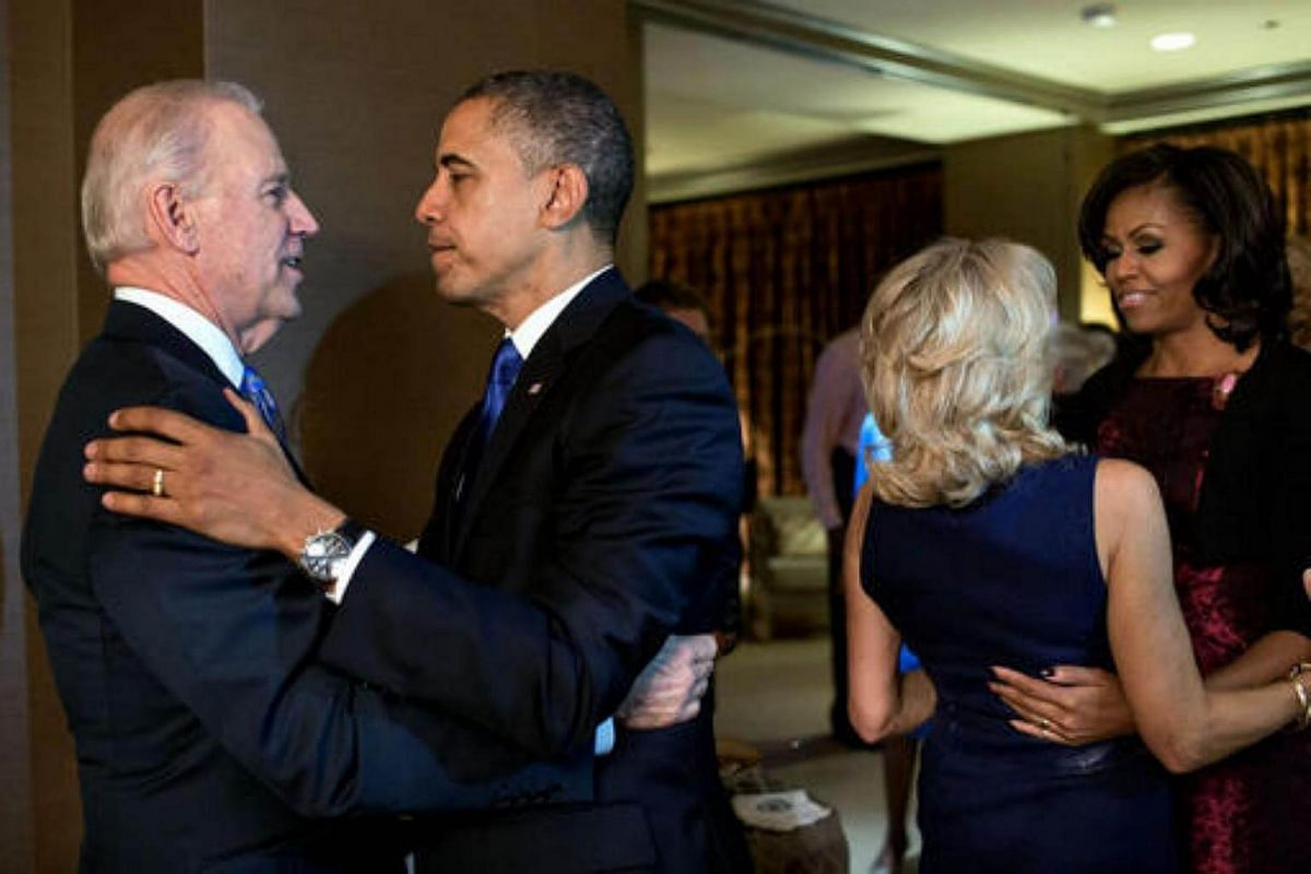 President Obama and First Lady Michelle Obama embrace Vice-President Biden and Jill Biden moments after the television networks called the 2012 election in their favour.