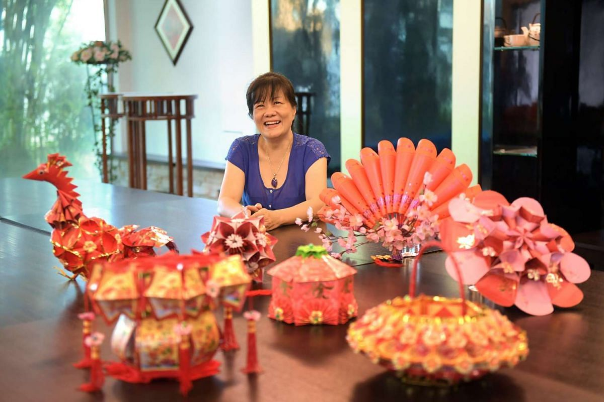 Crafted from hongbao, the lanterns of Madam Gladys Tan can sport floral shapes and intricate folds.
