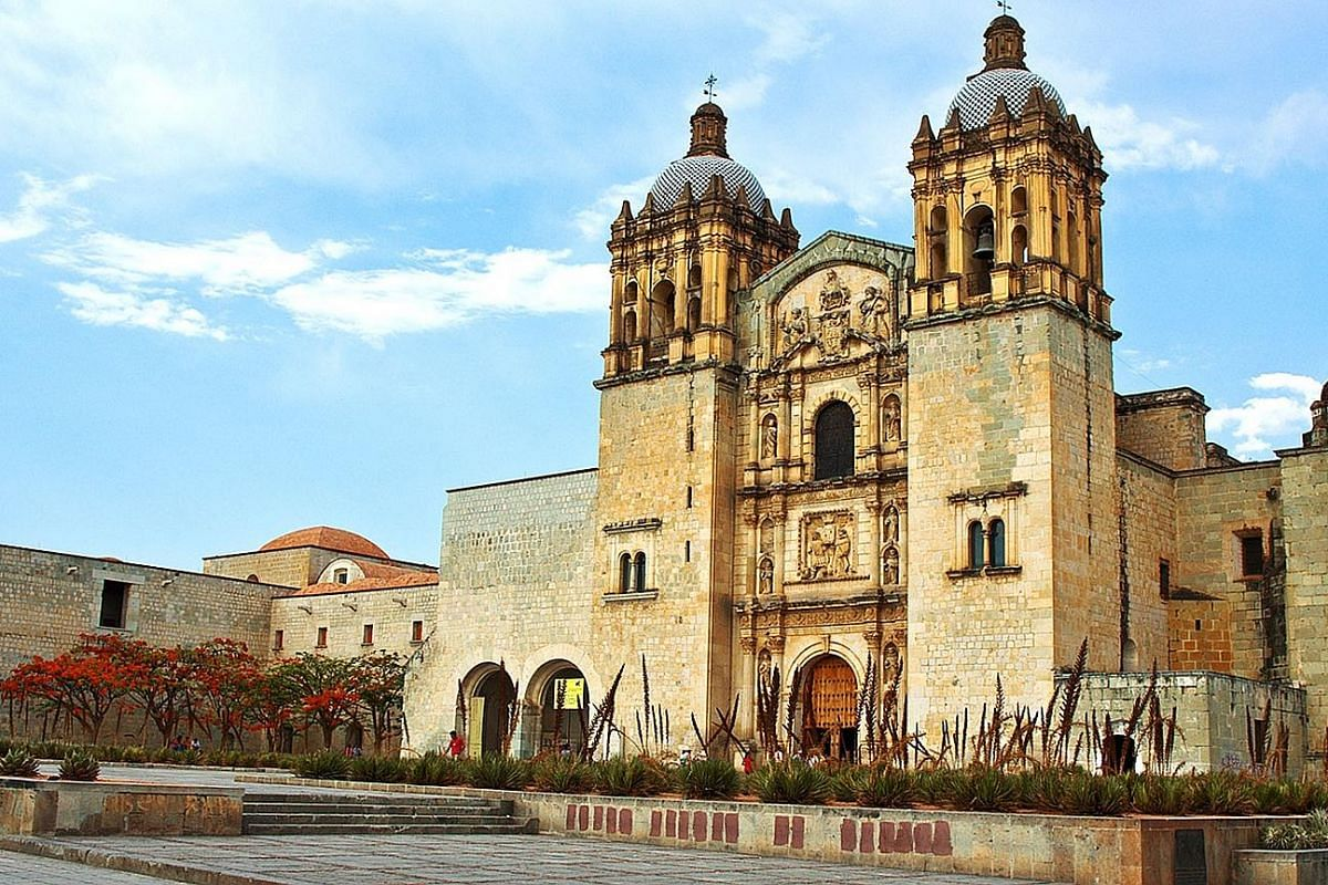 Construction of the baroque church, Templo De Santo Domingo De Guzman (above), began in the 16th century and took more than 100 years to complete. A vendor sells chapulines or fried grasshoppers (right). A farmer harvests agave plants (far left), whi