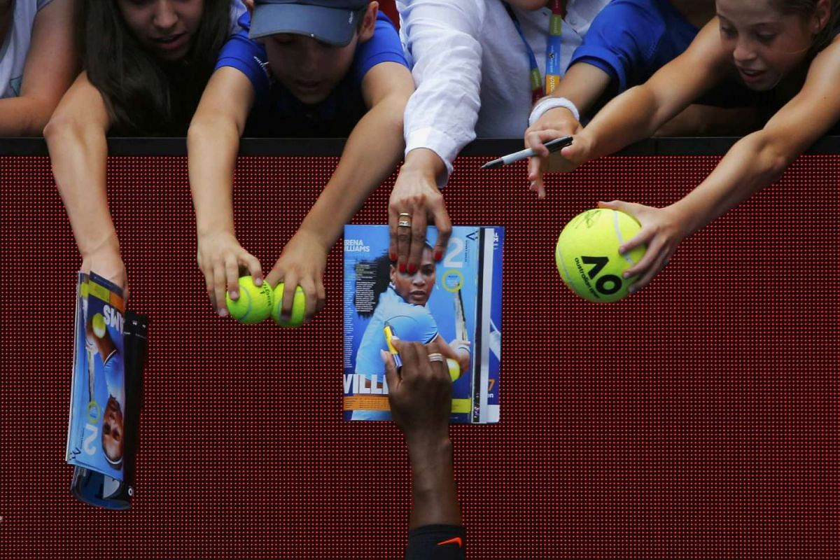 Serena Williams signs autographs after winning her Women's singles first round match against Belinda Bencic in a Tennis tournament at Melbourne on Jan 17, 2017.