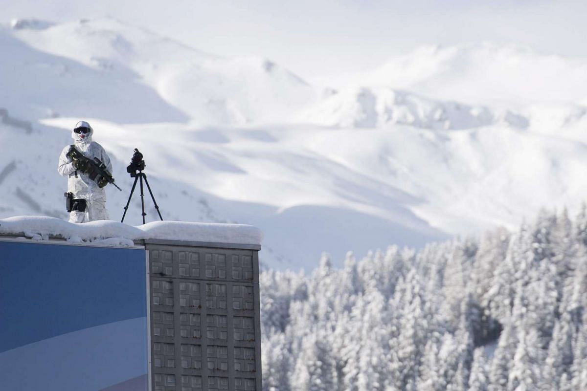 Police secure the roof of the Congress Centre where preparations are underway for the 47th Annual Meeting of the World Economic Forum in Davos on Jan 16, 2017.