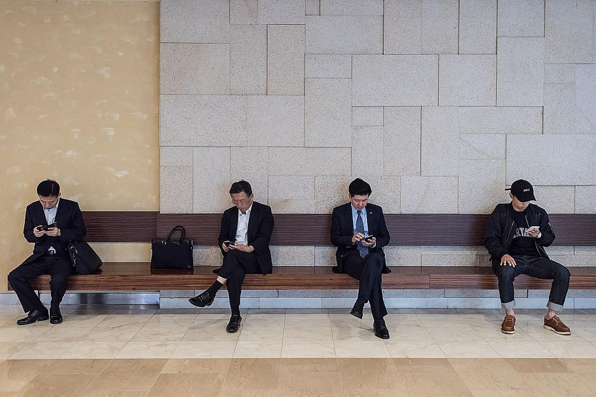 Living in one of the world's most connected societies means that employees in South Korea work 11 extra hours a week on average using electronic gadgets, said a study last year.