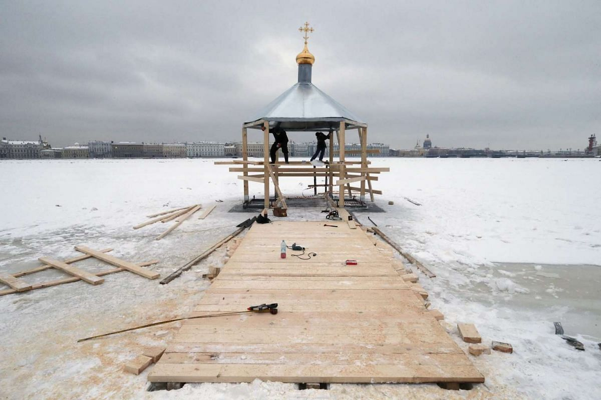 Municipal workers build a bath for the people who will take a dip in the ice water ahead of the Epiphany celebrations in St Petersburg, Russia on Jan 17, 2017.