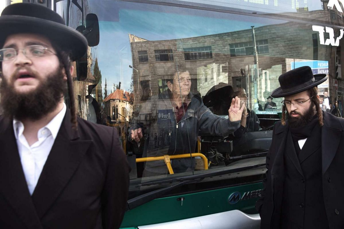 Ultra-Orthodox Jews block a bus during a protest against Ultra-Orthodox Jewish youth who serve in the Israeli army, in the neighbourhood of Mea Shearim in Jerusalem on Jan 17, 2017.