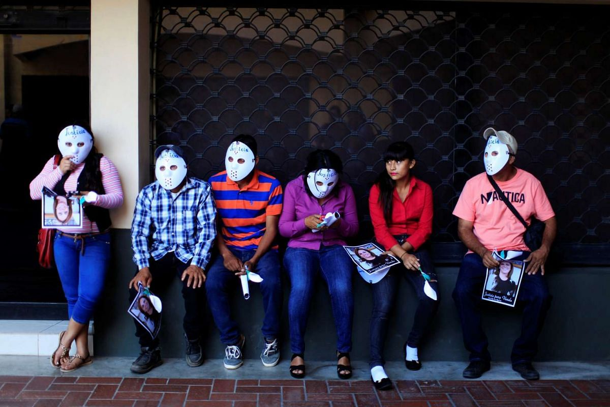 Supporters of former first lady of El Salvador Vanda Pignato rest after a hearing in a civil case for alleged corruption against her and former president Mauricio Funes in San Salvador, El Salvador on Jan 17, 2017.